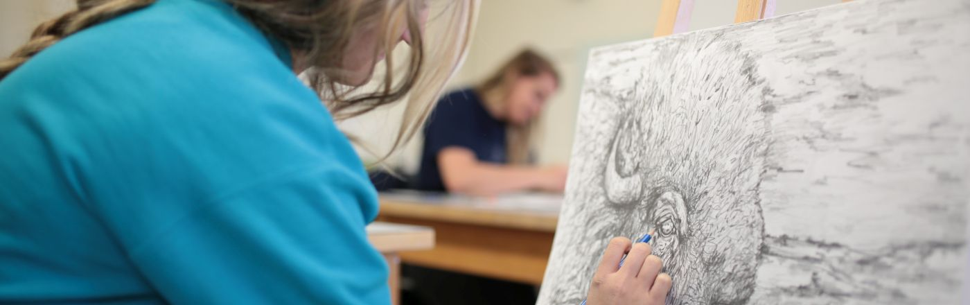 Student drawing in an art class